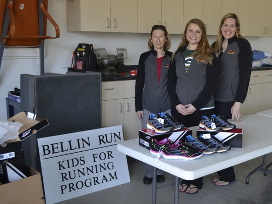 From right, coordinator Tia DeLeers, Krystle Kempen and Diana Perrault sort through boxes of new running shoes Tuesday that are being donated to more than 200 needy children participating in the Bellin Run Kids for Running program.