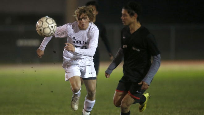 Maclay's Bradley Stager chases West Gadsden's German Fuentes for the ball during their District 1-1A final at Maclay School on Friday. Stager scored the first goal in a 7-0 win.