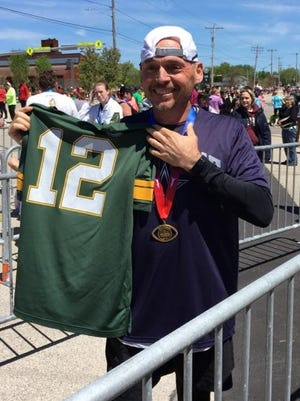 It was a tale of two jerseys for Bruce Hermans, who completed his first Cellcom Green Bay Marathon on Sunday.