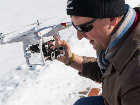 """University of Delaware researcher Arthur Trembanis holds a drone used to inspect land. """"I take out three batteries, and in a little over an hour, I can cover a mile of beach,"""" he says."""