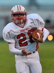 Medford's Conrad Bolz (28) runs the ball for a touchdown