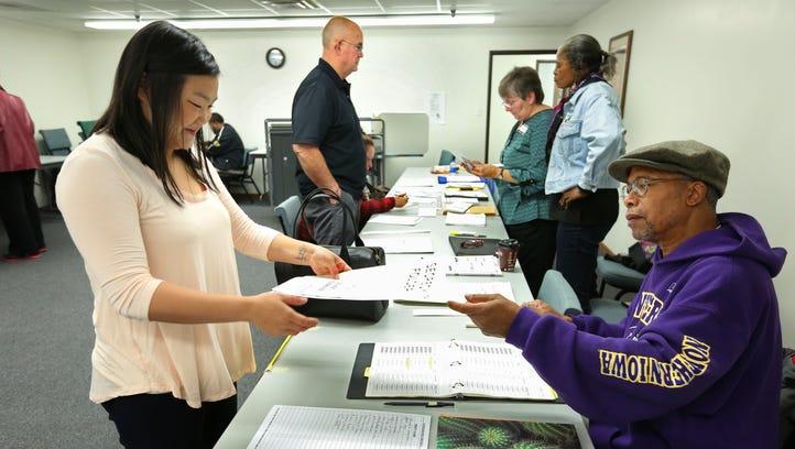 Corrin Hatala, of Des Moines' Drake neighborhood, receives