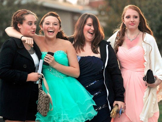 Students from Northeastern prepare to enter Homecoming at the school on Saturday.