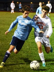 Stevenson's Noah Cook (left) tries to turn the corner