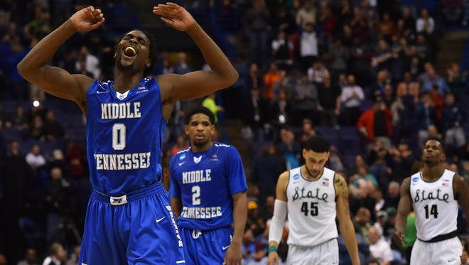 MTSU forward Darnell Harris (0) reacts after the game Friday.