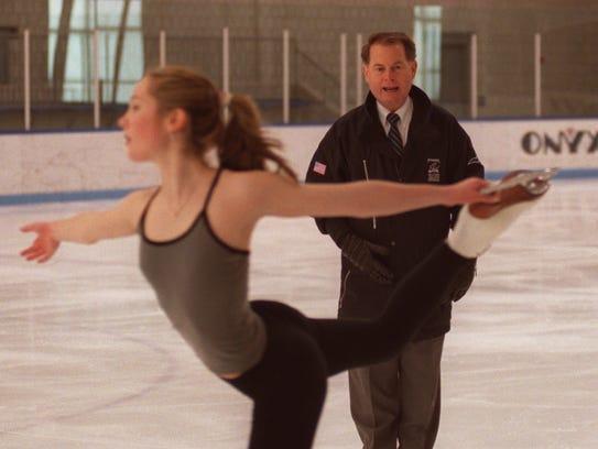 Figure skating coach Richard Callaghan keeps an eye
