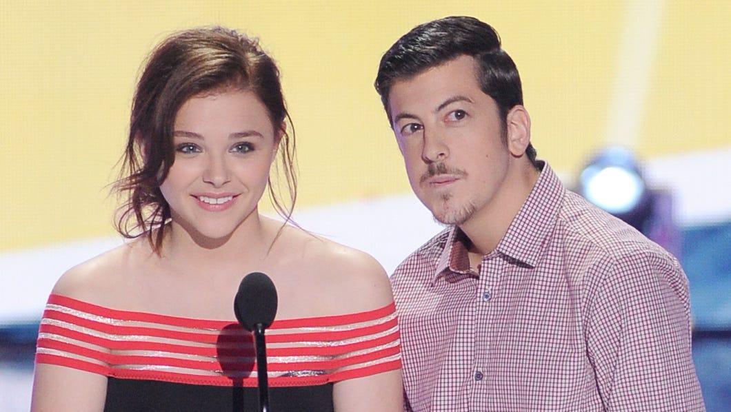 """Kick-Ass 2"" stars Chloe Grace Moretz and Christopher Mintz-Plasse take the stage."