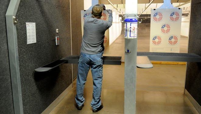 David Sweeter of St. Cloud takes a look at the targets at the Firing Line indoor range in Sauk Rapids.