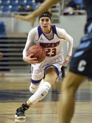 Reno's Mikayla Shults drives against Centennial during