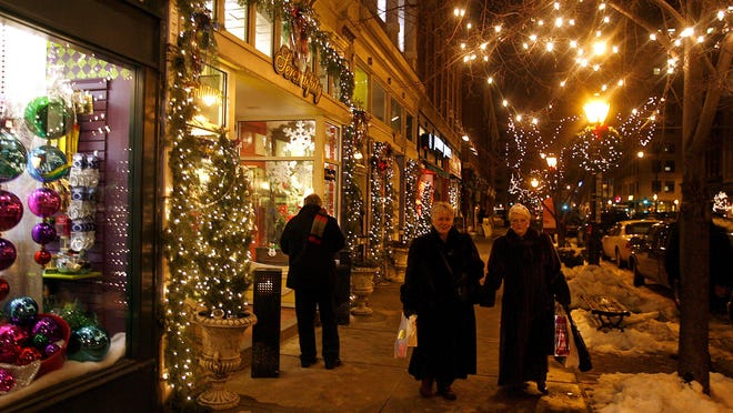 Shoppers walk along Sixth Street in December 2006 during the first evening of the Old Capitol Holiday Walk held each year in downtown Springfield.