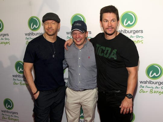 Donnie Wahlberg, from left, Paul Wahlberg and Mark Wahlberg.
