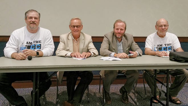 From left, Aaron Tobin, co-founder Save the Oak Park Jewish Community Center; Jewish Federation of Metro Detroit President Lawrence A. Wolfe; Scott Kaufman, CEO of the Jewish Federation of Metro Detroit and Prof. Ronald Aronson, with Save the Oak Park Jewish Community Center at the Oak Park Jewish Community Center Monday night concerning the outcome of the facility.