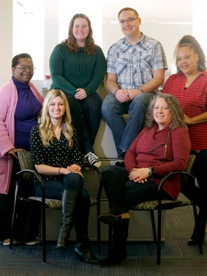 In an industry in which formal business wear has been the norm, employees at UMB Fund Services, including Charvonne Carlson (from left), a fund accountant; Amanda Barnes, a mutual fund administrator; Ally Worland, a research correspondence representative; Jason Kowalke, a senior fund administrator;  Lisa Drews Anderson, a fund accounting project manager; and Quana Harden, a Blue Sky specialist, often dress much more casually.