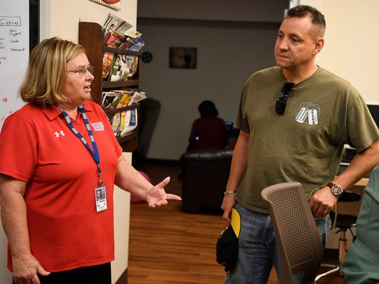 Tammy Bass talks with Army Captain Daniel Hernandez at the USO lounge at the Nashville International Airport Friday, Sept. 8, 2017 in Nashville, Tenn. Bass is a mother of a former soldier who was killed in action. He signed up to serve after 9/11, and now she's dedicating her life to those who serve.