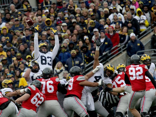 Michigan's Zach Gentry (83) tries to block a field goal by Ohio State in the first half at Ohio Stadium on Saturday, Nov. 26, 2016.