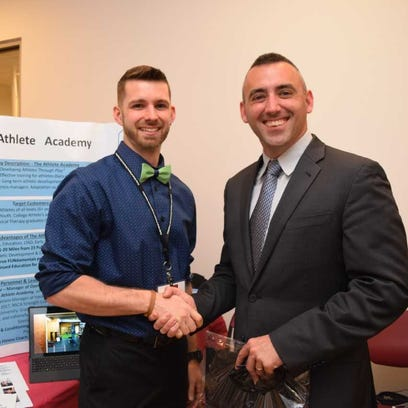 The Athlete Academy owner Cory Revel is congratulated