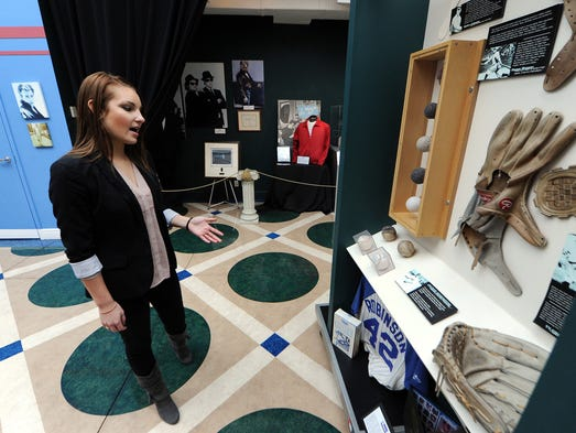 Megan Reinholt talks about a Jackie Robinson display inside the museum at CMG Worldwide, Thursday, January 9, 2014, in Fishers. CMG Worldwide represents over 200 diverse personalities and corporate clients in the sports, entertainment and music fields.