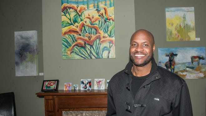 Kalonji Gilchrist, executive director and founder of 21 Dreams: Arts & Culture Collective, with some of the art on display in the group's new home at 540 Clay St., Montgomery, on Thursday, Feb. 1, 2018.