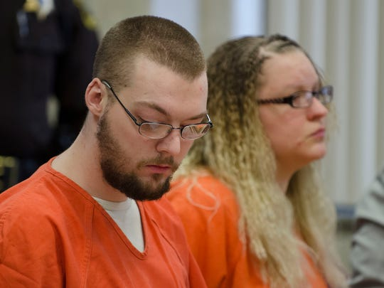 Andrew Maison looks down as he and his wife, Hilery, are sentenced in the 2015 death of his daughter, Mackenzie Thursday, March 10, 2016 in 31st Circuit Court in Port Huron.
