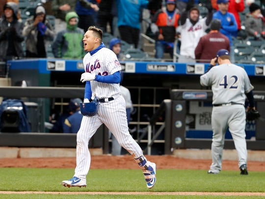 New York Mets' Wilmer Flores, left, runs the bases