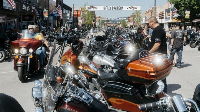 Motorcycle riders gather for the 80th Annual Sturgis Motorcycle Rally in South Dakota. This year's festival may attract about 250,000 people despite an uptick in coronavirus cases across the state, leading to fears it could become a super-spreader event. City leaders in Daytona Beach are monitoring how that event unfolds as they consider approving permits for this year's Biketoberfest.