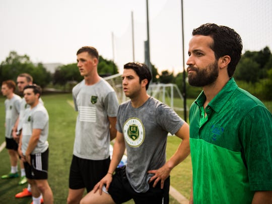 Richard Carrizales and his brother Marco watch a Greenville FC practice on Friday, June 22, 2018.