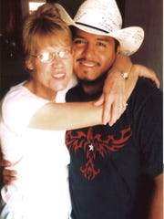 Betty Taylor and Julio Cortez during a trip to the San Angelo Speedway to watch George Taylor race on Aug. 21, 2005. Cortez was leaving Texas and had his hat signed by the Standard-Times staff.