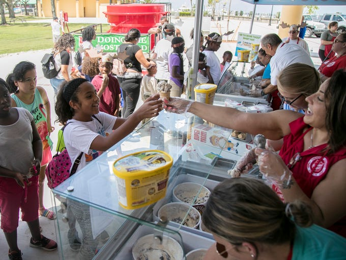 Jade Avendano, 11, gets her free cone of Moose Tracks