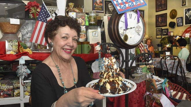 """Wanda Juneau, Back in Time owner, shows off her famous chocolate brownie covered with ice cream and whipped cream. Although the shop is known for this dessert, Back in Time took home the honor of """"Best Salad"""" for the Daily World """"Best of"""" awards."""