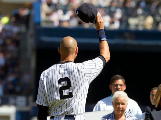 Yankees shortstop Derek Jeter salutes the crowd as he is honored at a ceremony before the game against the Kansas City Royals at Yankee Stadium on Sept. 7.