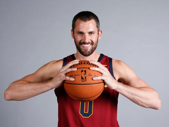 FILE - In this Sept. 25, 2017, file photo, Cleveland Cavaliers' Kevin Love poses for a portrait during the NBA basketball team media day, in Independence, Ohio. All-Star forward Kevin Love has signed a new four-year, $120 million contract with the Cleveland Cavaliers, who are beginning anew following LeBron James' departure. Love signed the extension Tuesday. (AP Photo/Ron Schwane, File)