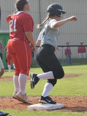 Rapides' Katie Couvillion (10, right) rounds first on her way to second in game play Saturday against Catholic-New Iberia.