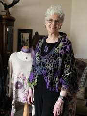 Terrie Voigt (cq) wearing a free-form crocheted sweater/cape,