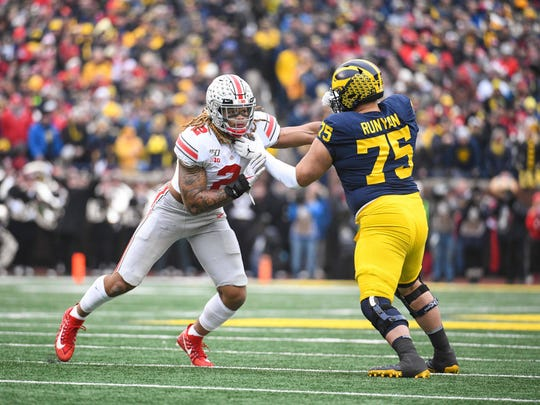 Nov 30, 2019; Ann Arbor, MI, USA; Ohio State Buckeyes defensive end Chase Young (2) battles for position with Michigan Wolverines offensive lineman Jon Runyan (75) during the game at Michigan Stadium. Mandatory Credit: Tim Fuller-USA TODAY Sports