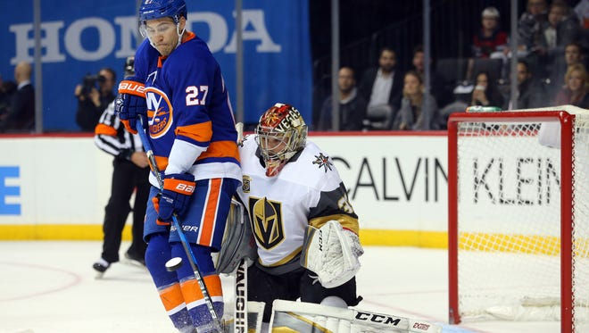 Vegas Golden Knights goalie Maxime Lagace (33) makes a save in front of New York Islanders center Anders Lee (27) during the second period at Barclays Center.