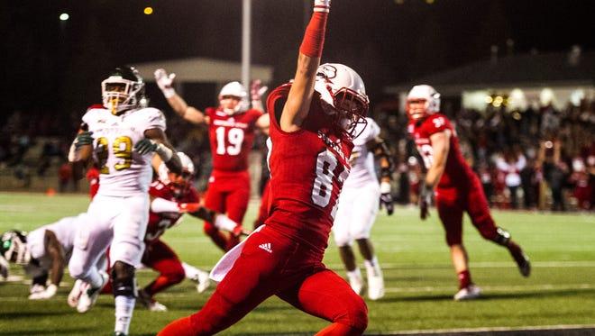 Southern Utah University's Austin Ewing (87) celebrates a touchdown against Sacramento State at SUU Saturday, October 13, 2018.