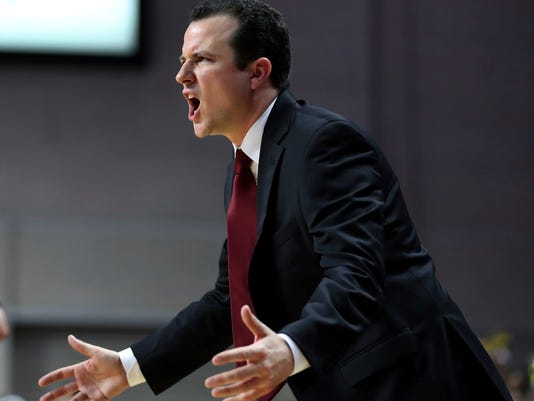 "FILE - In this March 11, 2017, file photo, New Mexico State coach Paul Weir yells to his team during the second half of an NCAA college basketball game against Cal State Bakersfield in the final of the Western Athletic Conference tournament, in Las Vegas. New Mexico looked to its own backyard for a new men's basketball coach by hiring NMSU head coach Paul Weir to lead the Lobos. ""In conducting this search, his was a name that was on our radar from the beginning,"" New Mexico athletic director Paul Krebs said in a statement Tuesday, April 11, 2017,  announcing Weir's hiring. (AP Photo/L.E. Baskow, File)"