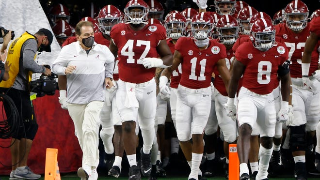 Alabama coach Nick Saban runs onto the field with his team before the Rose Bowl on Jan. 1.