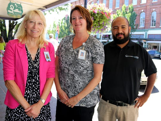 From left, Verena Wessel, Kellee Borsberry and Memo Plazas say comprehensive health care is available for the needy.