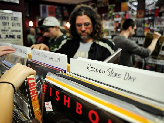 Mick Hickman, of Keizer, sorts through vinyl during Record Store Day at Ranch Records in Salem.