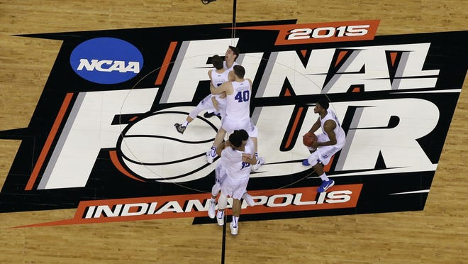 Duke players celebrate after the NCAA Final Four tournament championship game against Wisconsin  Monday, April 6, 2015, in Indianapolis. Duke won 68-63.