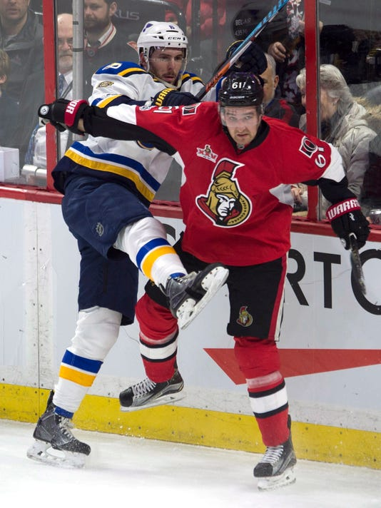 St. Louis Blues defenseman Joel Edmundson (6) collides with Ottawa Senators right wing Mark Stone (61) behind the net during the second period of an NHL hockey game Tuesday, Feb. 7, 2017, in Ottawa, Ontario. (Adrian Wyld/The Canadian Press via AP)