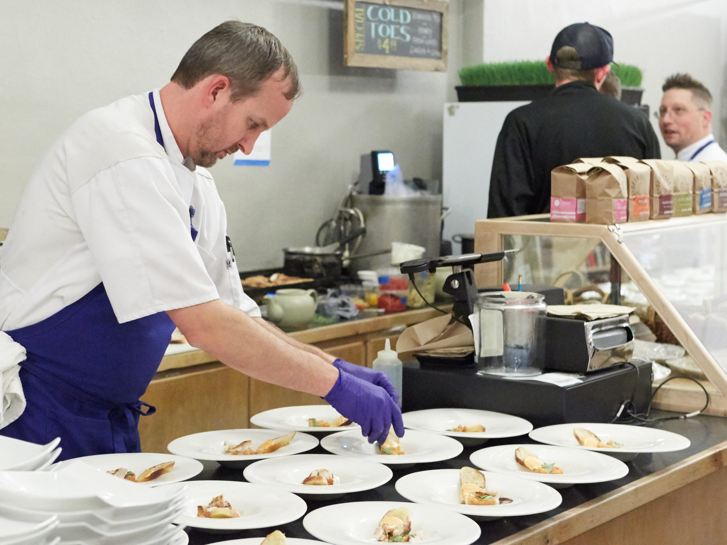 Chef Jason Shaeffer plates the first course during