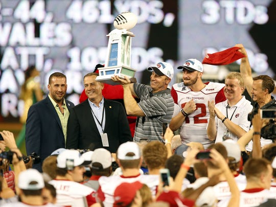 Then coach of the Western Kentucky Hilltoppers head coach Jeff Brohm, center, celebrates by holding the championship trophy after defeating the South Florida Bulls in the 2015 Miami Beach Bowl at Marlins Park. Dec 21, 2015
