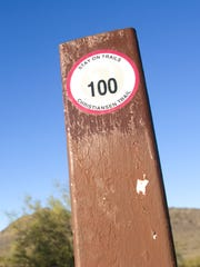A marker for Trail 100 in the Phoenix Mountains Preserve.