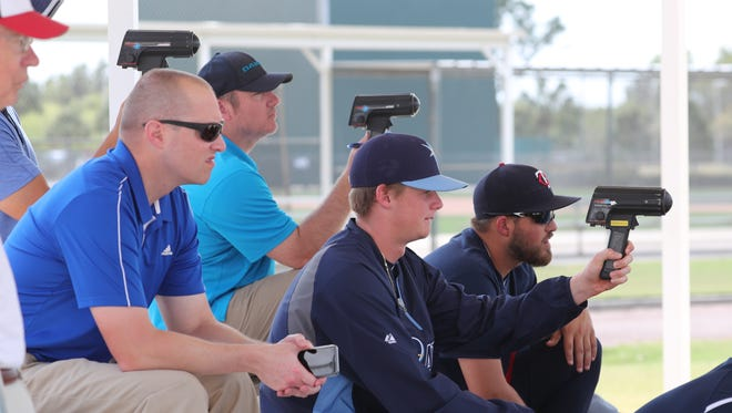 Scouts and team members run  their speed guns as pitchers switch in and out. Minor league camp can beat big-league camp from a fan's perspective. You can get up close to future big league players and all the action. Many spectators become friends and get an inside scoop to the future team.