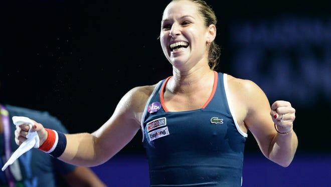 Dominika Cibulkova of Slovakia celebrates her victory over Svetlana Kuznetsova.