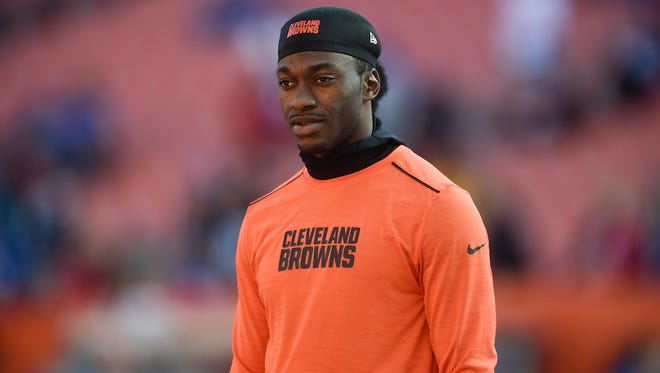 Cleveland Browns quarterback Robert Griffin III walks the field during practice before an NFL football game against the New York Giants, Sunday, Nov. 27, 2016, in Cleveland.