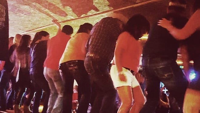 """Closing out each show at Whiskey River is the bar dance, when folks dance atop the bar — a tradition that preceded the """"Coyote Ugly"""" film."""