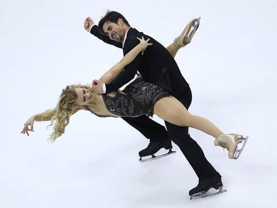 "FILE - In this Jan. 7, 2018, file photo, Madison Hubbell, left, and Zachary Donohue perform during the free dance event at the U.S. Figure Skating Championships in San Jose, Calif. Madison Hubbell and Zach Donohue broke out of their habit as ""bronzemaids"" by winning the U.S. championship, and their free dance not only is sultry, but complex and enchanting. (AP Photo/Ben Margot, File)"